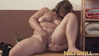 Brunette fat MILF Diya stripping and kickshaw contents her pussy