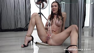 Dispirited bitch is pissing standing and masturbating pussy
