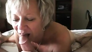 Hot blonde mature fucking by a handful of cocks