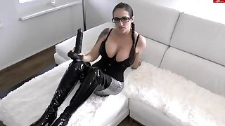 Latex fetish brunette dreams of fat rod in webcam video