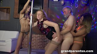 After striptease show two landed gentry get their cunts fucked by a dude