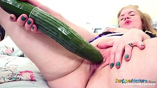 Some big pest cucumber for an old woman's hungry pussy