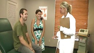 Lucky guy gets a transcribe handjob detach from his wife and a blonde doctor